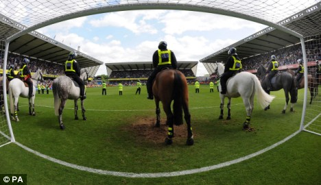Teams line up in earlier meeting at Millwall