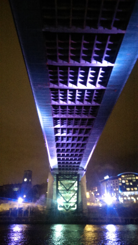 Underside of Tyne Bridge at night