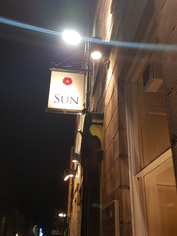 sun-at-night-sign