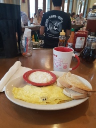 Ruby Slipper Louisianan Omlet and grits with sourdough toast[1]